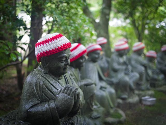 Monks in hats.